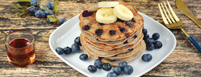 Plate with small pancakes with berries