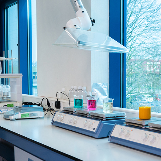 Vitablend's lab with view on a scale and beakers