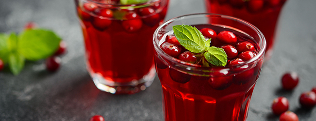 glasses of cranberry juice with fresh cranberries