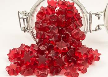 star shaped gummy candy in a glass jar
