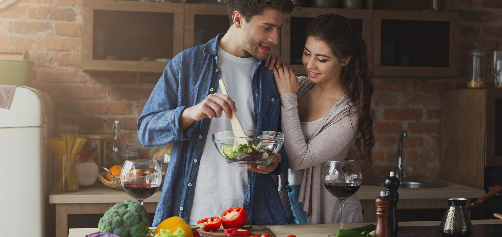 Couple making a healthy salad in the kitchen