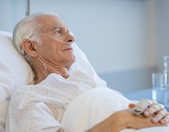 Elder man in a hospital bed
