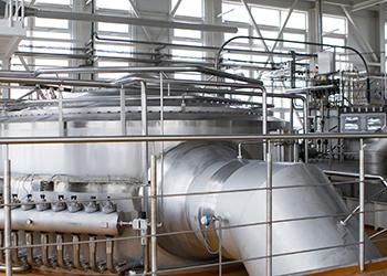 milk processing equipment inside a factory