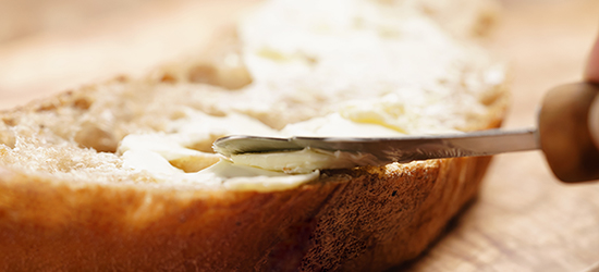 Butter being spread on bread