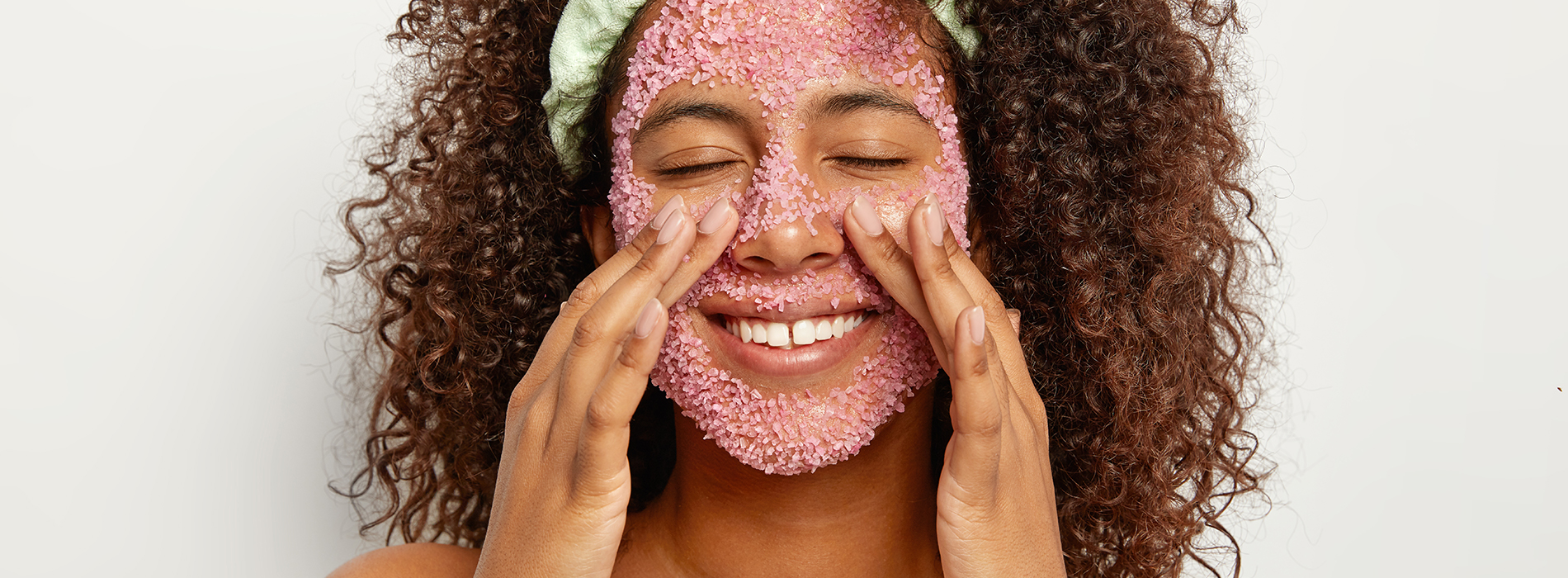 Woman applying a skincare facemask