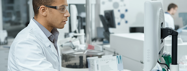 Scientist using a computer in a lab
